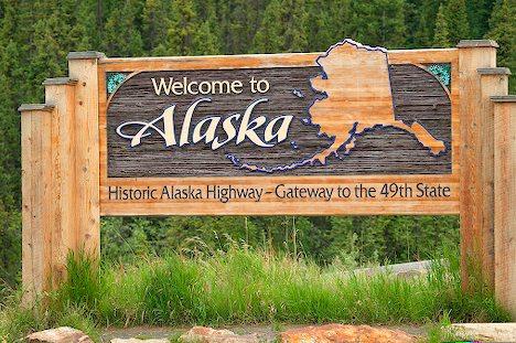 Welcome to Alaska sign at the Alaska / Canada border.